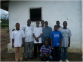 Rev. K. Zubah Kollie, Jr. with the Vezala Church men during his visit there